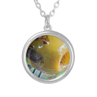 Closeup grilled olive on the fork silver plated necklace