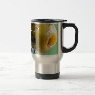 Closeup grilled olive on the fork travel mug