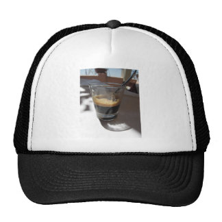 Closeup of espresso coffee in a glass cup trucker hat