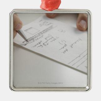 Closeup of hands signing prescription Silver-Colored square ornament