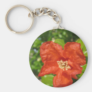 Closeup of red pomegranate flower keychain