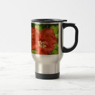 Closeup of red pomegranate flower travel mug