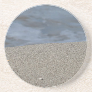 Closeup of sand beach with sea blurred background beverage coasters