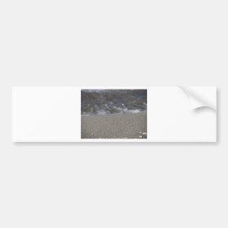 Closeup of sand beach with sea blurred background bumper sticker