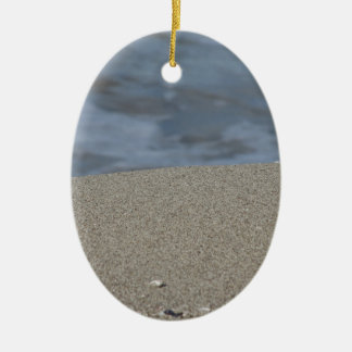 Closeup of sand beach with sea blurred background ceramic ornament