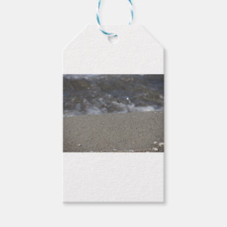 Closeup of sand beach with sea blurred background gift tags