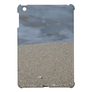 Closeup of sand beach with sea blurred background iPad mini case