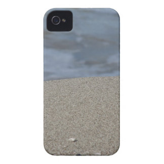 Closeup of sand beach with sea blurred background iPhone 4 cases