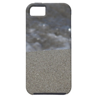Closeup of sand beach with sea blurred background iPhone 5 cover