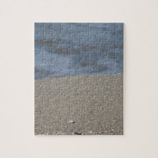 Closeup of sand beach with sea blurred background jigsaw puzzle