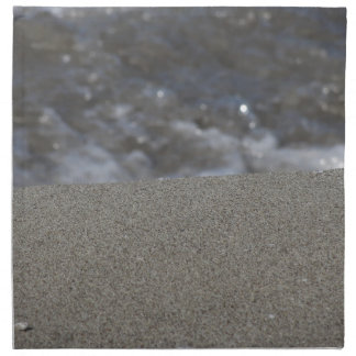 Closeup of sand beach with sea blurred background napkin