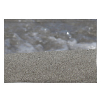 Closeup of sand beach with sea blurred background placemat