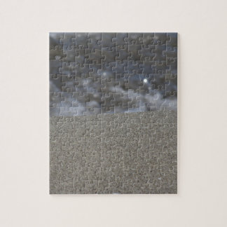 Closeup of sand beach with sea blurred background puzzle