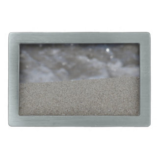 Closeup of sand beach with sea blurred background rectangular belt buckle