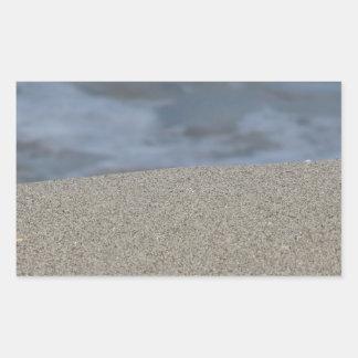 Closeup of sand beach with sea blurred background sticker