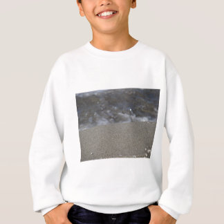 Closeup of sand beach with sea blurred background sweatshirt