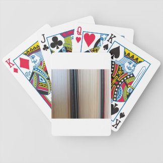 Closeup of second hand books standing on a table bicycle playing cards