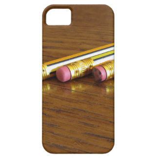 Closeup of used pencil erasers on wooden table case for the iPhone 5