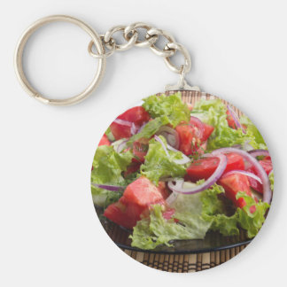 Closeup plate with a salad of chopped tomato slice basic round button keychain