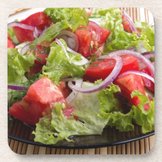 Closeup plate with a salad of chopped tomato slice drink coasters