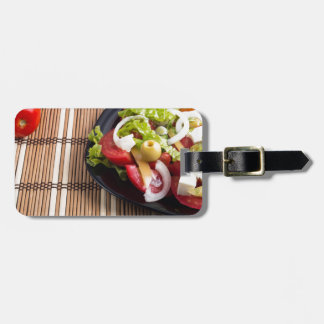 Closeup view fresh natural salad with raw tomato luggage tag