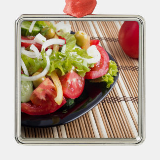 Closeup view fresh natural salad with raw tomato Silver-Colored square ornament