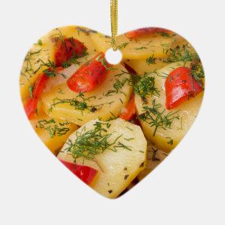 Closeup view of a vegetarian dish of natural ceramic heart ornament