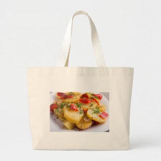 Closeup view of a vegetarian dish of natural large tote bag