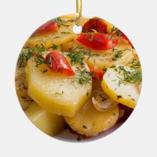 Closeup view of a vegetarian dish of natural round ceramic ornament