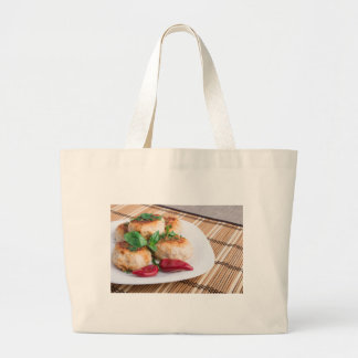 Closeup view of the fried meatballs on a stripe large tote bag