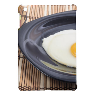 Closeup view on fried eggs with yolk on a plate iPad mini covers