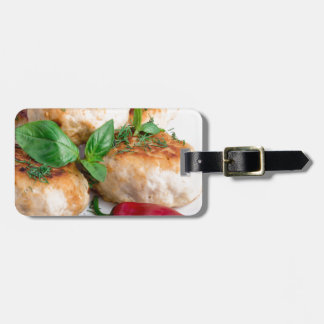 Closeup view on fried meatballs of minced chicken bag tag