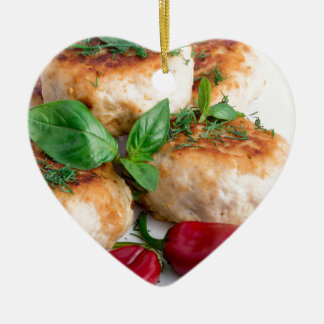 Closeup view on fried meatballs of minced chicken ceramic heart ornament