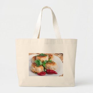 Closeup view on fried meatballs of minced chicken large tote bag
