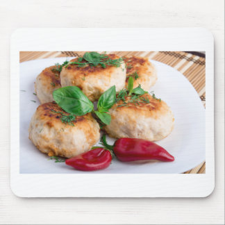 Closeup view on fried meatballs of minced chicken mouse pad
