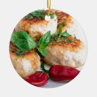 Closeup view on fried meatballs of minced chicken round ceramic ornament