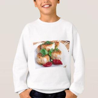 Closeup view on fried meatballs of minced chicken sweatshirt