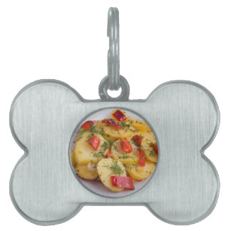 Closeup view on slices of potato stew pet ID tags