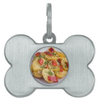 Closeup view on slices of potato stew pet name tag