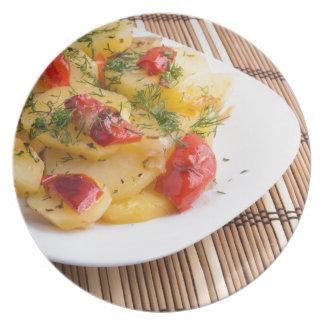 Closeup view on slices of potato stew plates