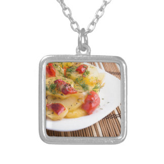Closeup view on slices of potato stew silver plated necklace