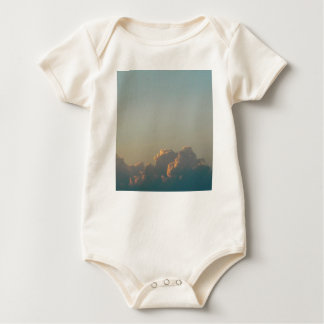 clouds in romania baby bodysuit