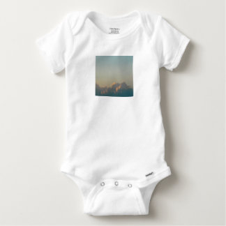 clouds in romania baby onesie