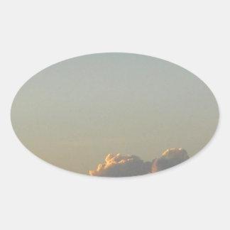 clouds in romania oval sticker
