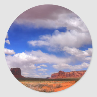 Clouds over the desert classic round sticker