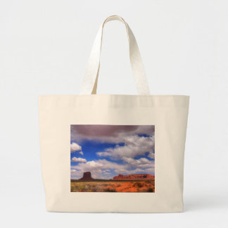 Clouds over the desert large tote bag