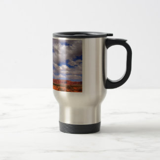 Clouds over the desert travel mug