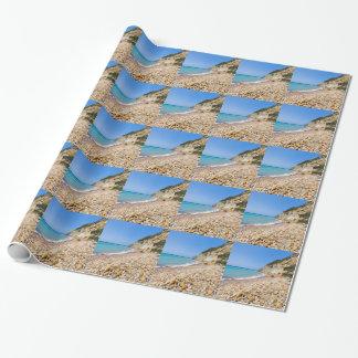 Coast landscape with stony beach and blue sea