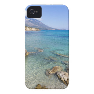 Coast with blue sea rocks and mountains in Greece iPhone 4 Cases