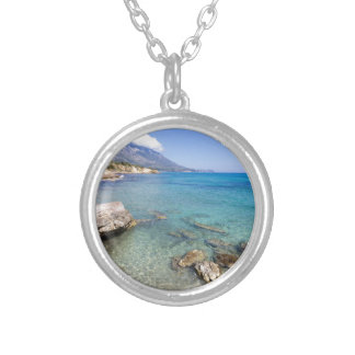 Coast with blue sea rocks and mountains in Greece Silver Plated Necklace